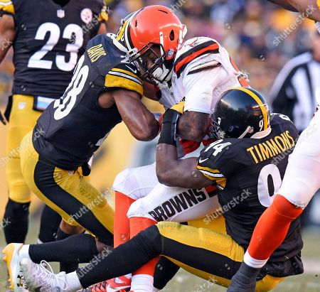 George Atkinson, Lawrence Timmons, Sean Davis Cleveland Browns running back George Atkinson is tackled by Pittsburgh Steelers inside linebacker Lawrence Timmons (94) and strong safety Sean Davis (28) during the second half of an NFL football game in Pittsburgh