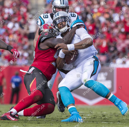Tampa Bay Buccaneers defensive end Robert Ayers (91) tackles Carolina Panthers quarterback Cam Newton (1) in the 1st half in the game between the Carolina Panthers and the Tampa Bay Buccaneers at Raymond James Stadium in Tampa, Florida