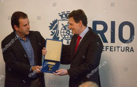 Marcelo Crivella, Eduardo Paes Evangelical bishop and senator Marcelo Crivella, right, receives the key of the city from the former mayor Eduardo Paes during his inauguration ceremony in Rio de Janeiro, Brazil, . (AP Photo/Leo Correa