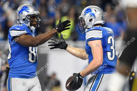 Anquan Boldin, Zach Zenner Detroit Lions fullback Zach Zenner, right, is congratulated by wide receiver Anquan Boldin after scoring a touchdown during the first half of an NFL football game against the Green Bay Packers, in Detroit