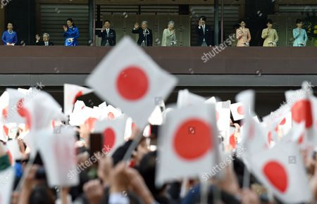Japan's Emperor Akihito (5-L) with Empress Michiko (5-R) wave to well-wishers through bullet-proof glass from a balcony with Crown Prince Naruhito (4-L), Crown Princess Masako (3-L), Prince Hitachi (2-L) and Princess Hitachi (L), Prince Akishino (4-R), Princess Akishino (3-R), Princess Mako (2-R), Princess Kako (R) during the New Year's public appearance at the Imperial Palace in central Tokyo, Japan, 02 January 2017. Emperor Akihito and royal family members greeted well-wishers for the new year.