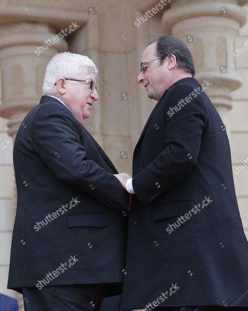 Francois Hollande and Fuad Masum