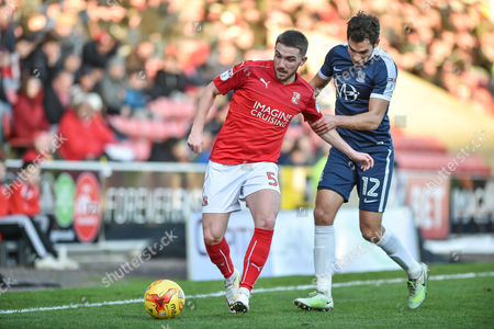 Swindon Town Midfielder, Anton Rodgers (5) and Southend United Midfielder, Will Atkinson (12) during the EFL Sky Bet League 1 match between Swindon Town and Southend United at the County Ground, Swindon