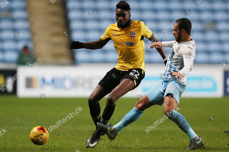 Sammy Ameobi of Bolton Wanderers and Marcus Tudgay of Coventry City during the Sky Bet League One match between Coventry City and Bolton Wanderers played at the Ricoh Arena, Coventry on 2nd January 2017