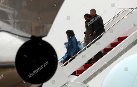 Barack Obama, Michelle Obama, Sasha Obama, Malia Obama President Barack Obama, right, with first lady Michelle Obama, and daughters Sasha and Malia Obama, step off Air Force One as they arrive, at Andrews Air Force Base, Md., as they return from Hawaii