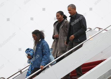 Barack Obama, Michelle Obama, Sasha Obama President Barack Obama, first lady Michelle Obama and their daughter Sasha arrive on Air Force One, in Andrews Air Force Base, Md., en route to Washington as they return from their annual vacation in Hawaii