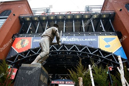 Stock Image of Rain falls on the Stan Musial statue located outside of the third base gate prior to the NHL Winter Classic hockey game between the St. Louis Blues and the Chicago Blackhawks at Busch Stadium, in St. Louis