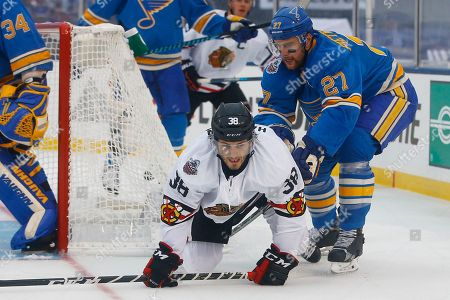 Ryan Hartman, Alex Pietrangelo Chicago Blackhawks' Ryan Hartman,bottom left, is checked to the ice by St. Louis Blues' Alex Pietrangelo during the first period of the NHL Winter Classic hockey game at Busch Stadium, in St. Louis