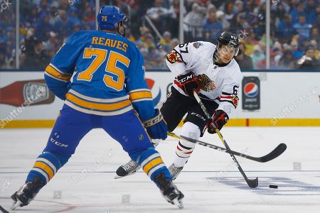 Tanner Kero, Ryan Reaves Chicago Blackhawks' Tanner Kero, right, skates with the puck as he is defended by St. Louis Blues' Ryan Reaves during the first period of the NHL Winter Classic hockey game at Busch Stadium, in St. Louis