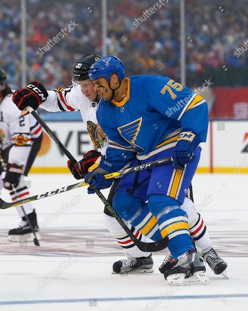 Ryan Reaves, Dennis Rasmussen St. Louis Blues' Ryan Reaves, front right, and Chicago Blackhawks' Dennis Rasmussen, of Sweden, battle for position on a face-off during the first period of the NHL Winter Classic hockey game at Busch Stadium, in St. Louis