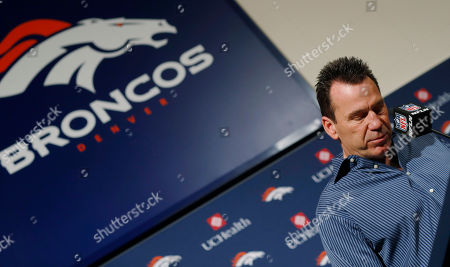 Gary Kubiak bows his head as he steps down as head coach of the Denver Broncos because of health concerns, at team headquarters in Englewood, Colo