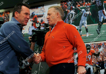 Gary Kubiak, John Elway Gary Kubiak, left, shakes hands with Denver Broncos general manager John Elway as Kubiak heads to the podium to step down as head coach of the Broncos because of health concerns, at team headquarters in Englewood, Colo