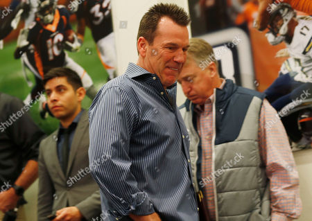 Gary Kubiak, Joe Ellis Gary Kubiak, front, heads to the podium as he steps down as head coach of the Denver Broncos because of health concerns, at team headquarters in Englewood, Colo. Joe Ellis, right, Broncos president, chief executive officer and chairman, stands by
