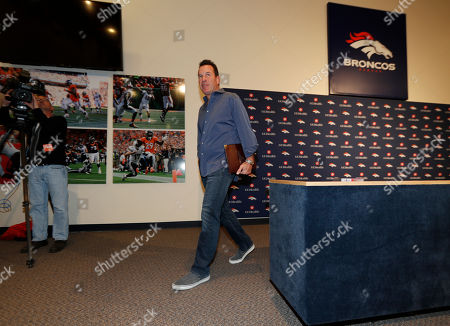 Gary Kubiak walks away after he stepped down as head coach of the Denver Broncos because of health concerns, at team headquarters in Englewood, Colo