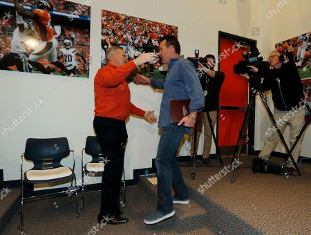 Gary Kubiak, John Elway Denver Broncos general manager John Elway, left, hugs Gary Kubiak after Kubiak stepped down as head coach of the Denver Broncos because of health concerns, at team headquarters in Englewood, Colo
