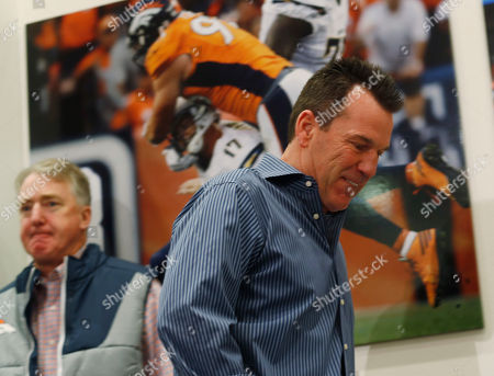 Gary Kubiak, Joe Ellis Gary Kubiak, front, heads to the podium to step down as head coach of the Denver Broncos because of health concerns, at team headquarters in Englewood, Colo. Joe Ellis, team chief executive officer and president, left, looks on