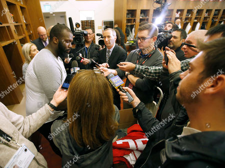 San Francisco 49ers defensive lineman Quinton Dial, left, speaks to the media inside the teams locker room, in Santa Clara, Calif