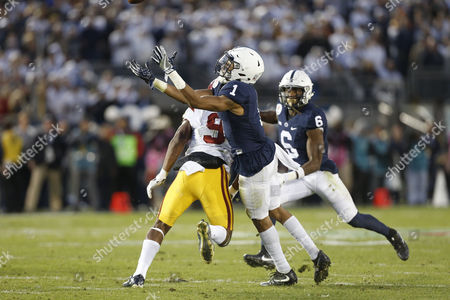 Penn State Nittany Lions cornerback Christian Campbell #1 tips a pass intended for USC Trojans wide receiver JuJu Smith-Schuster #9 which would be intercepted by Penn State Nittany Lions linebacker Brandon Bell #11 during the Rose Bowl game presented by Northwestern Mutual between the USC Trojans and the Penn State Nittany Lions at the Rose Bowl in Pasadena, California