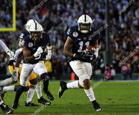Penn State Nittany Lions linebacker Brandon Bell #11 returns an interception for a touchdown during the 2016 Northwestern Mutual Rose Bowl between the USC Trojans and the Penn State Nittany Lions at the Rose Bowl Stadium in Pasadena, CA