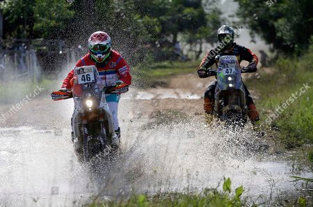Fabricio Fuentes, Jose Julian Kozac Fabricio Fuentes, of Bolivia, left, rides his KTM motorbike ahead of Jose Julian Kozac, of Argentina, on a KTM motorbike, during the first stage of the Dakar Rally between Asuncion, Paraguay and Resistencia, Argentina, . The race will pass through Bolivia as well