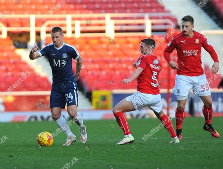 Stock Picture of Jason Demetriou of Southend United gets past Anton Rodgers of Swindon Town