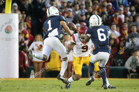 Penn State Nittany Lions cornerback Christian Campbell #1 tries to catch to tipped pass which is eventually intercepted by Penn State Nittany Lions linebacker Brandon Bell #11 for a big USC turnover in the game between the USC Trojans and Penn State Nittany Lions, The Rose Bowl, Pasadena, CA