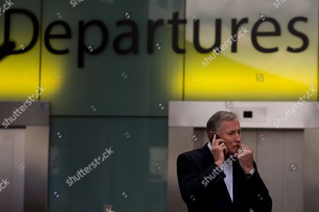 Steve Ridgway Ceo of Virgin Atlantic is Seen During an Interview to the Media on the Phone in Gatwick Airport London Britain 16 April 2012 Flights in and out of Gatwick Airport Were Suspended After a Plane was Forced to Make an Emergency Landing After Smoke was Reported in the Cabin Virgin Flight Vs27 Had Left the West Sussex Airport at 10:48 Bst and was Bound For Orlando in the Us when It Had to Return to Land at 12:30 Bst Four Passengers Suffered Minor Injuries During the Evacuation According to the Bbc the Airport Said Flights Were 'Slowly Resuming' But Warned Passengers of Knock-on Delays United Kingdom London