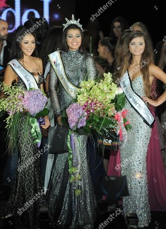 Miss World Next Top Model Mina Milutinovic From Serbia (c) 1st Runner Up Russian Ulyana Berdysheva (r) and 2nd Runner Up Kannika Khunkaeo (l) From Thailand Pose For Photographs After Being Crowned During a Miss World Next Top Model 2012 Contest in Beirut Lebanon Late 15 July 2012 Thirty Six Models From All Over the World Competed For the Title Lebanon Beirut