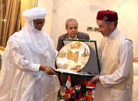 Chairman of Libya's National Transitional Council (ntc) Mustafa Abdul Jalil (r) Presents a Gift to Niger Prime Minister Brigi Rafini (l)in Tripoli Libya 04 May 2012 Libyan Arab Jamahiriya Tripoli