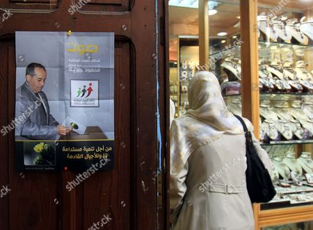 An Election Poster of the National Forces Alliance a Coalition of Political Parties and Ngos Depictng Its Head Former Transitional Council Foreign Minister Mahmoud Jibril (l) Seen at the Door of a Jewellery Shop in the Old Town of Tripoli Libya 05 July 2012 Elections Will Proceed in Libya As Planned the Ruling Council Said on 05 July Despite Security Concerns and Attacks on Election Commission Offices in Eastern Cities Equipment Needed For the Elections Including Ballot Papers was Destroyed in a Fire in the City of Ajdabiya Earlier Same Day According to Witnesses Quoted by Residents in the Capital Tripoli Some 2 7 Million Voters Will Head to the Polls on 07 July to Elect the 200-member Congress Which Will Draw Up a New Constitution and Form a Government Libyan Arab Jamahiriya Tripoli