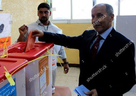 Mustafa Abdel Jalil (r) Chairman of Libya's Ruling National Transitional Council (ntc) Casts His Ballot in the National Congress Elections at a Polling Station Baida Some 200km East of Benghazi Libya 07 July 2012 Voters Were to Head to the Polls Across Libya on 07 July to Elect a 200-seat National Congress Which Will Have Legislative Powers and Appoint a New Government Amid Fears of Violence and Calls For Boycott in Eastern Cities Around 2 7 Million Libyans Have Registered to Vote to Elect the Assembly Consisting of 120 Directly Elected Members and 80 For Contenders From Party Lists Libyan Arab Jamahiriya Baida