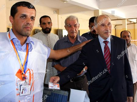 Mustafa Abdel Jalil (2-r) Chairman of Libya's Ruling National Transitional Council (ntc) Shows His Voter Id Before Casting His Vote in the National Congress Elections at a Polling Station Baida Some 200km East of Benghazi Libya 07 July 2012 Voters Were to Head to the Polls Across Libya on 07 July to Elect a 200-seat National Congress Which Will Have Legislative Powers and Appoint a New Government Amid Fears of Violence and Calls For Boycott in Eastern Cities Around 2 7 Million Libyans Have Registered to Vote to Elect the Assembly Consisting of 120 Directly Elected Members and 80 For Contenders From Party Lists Libyan Arab Jamahiriya Baida