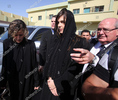 Australian Lawyer Melinda Taylor (c) and Her Interpreter From Lebanon Helen Assaf (l) Are Seen Following Their Release From Detention in Zintan a Town Southwest of Tripoli Libya 02 July 2012 Libya Released Four International Criminal Court Officials Detained Since Early June on Suspicion of Smuggling Documents to the Son of Slain Leader Moamer Gaddafi the Officials Were Released in the Western Town of Zintan where They Were Arrested by a Local Militia After a Visit to Saif Al-islam Gaddafi who is Wanted by the Icc For His Role in the Killing of Protesters During a Revolt Last Year That Ended His Father's Rule the Arrest of Australian Melinda Taylor the Icc-appointed Defence Counsel For Saif Al-islam Gaddafi and a Lebanese Translator on June 9 Deepened a Dispute Between the Icc and Libya Two Other Icc Officials who Had Stayed with Taylor Were Also Released Libyan Arab Jamahiriya Tripoli