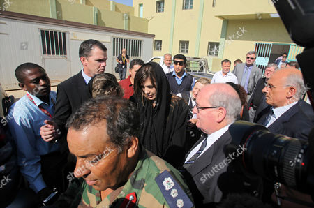 Australian Lawyer Melinda Taylor (c) is Seen Following Her Release From Detention in Zintan a Town Southwest of Tripoli Libya 02 July 2012 Libya Released Four International Criminal Court Officials Detained Since Early June on Suspicion of Smuggling Documents to the Son of Slain Leader Moamer Gaddafi the Officials Were Released in the Western Town of Zintan where They Were Arrested by a Local Militia After a Visit to Saif Al-islam Gaddafi who is Wanted by the Icc For His Role in the Killing of Protesters During a Revolt Last Year That Ended His Father's Rule the Arrest of Australian Melinda Taylor the Icc-appointed Defence Counsel For Saif Al-islam Gaddafi and a Lebanese Translator on June 9 Deepened a Dispute Between the Icc and Libya Two Other Icc Officials who Had Stayed with Taylor Were Also Released Epa/sabri Elmhedwi Libyan Arab Jamahiriya Tripoli