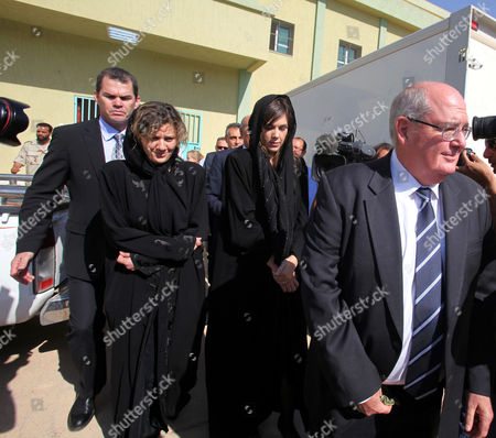 Australian Lawyer Melinda Taylor (2-r) and Her Interpreter From Lebanon Helen Assaf (2-l) Are Seen Following Their Release From Detention in Zintan a Town Southwest of Tripoli Libya 02 July 2012 Libya Released Four International Criminal Court Officials Detained Since Early June on Suspicion of Smuggling Documents to the Son of Slain Leader Moamer Gaddafi the Officials Were Released in the Western Town of Zintan where They Were Arrested by a Local Militia After a Visit to Saif Al-islam Gaddafi who is Wanted by the Icc For His Role in the Killing of Protesters During a Revolt Last Year That Ended His Father's Rule the Arrest of Australian Melinda Taylor the Icc-appointed Defence Counsel For Saif Al-islam Gaddafi and a Lebanese Translator on June 9 Deepened a Dispute Between the Icc and Libya Two Other Icc Officials who Had Stayed with Taylor Were Also Released Libyan Arab Jamahiriya Tripoli
