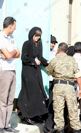 Australian Lawyer Melinda Taylor (2-l) is Seen Following Her Release From Detention in Zintan a Town Southwest of Tripoli Libya 02 July 2012 Libya Released Four International Criminal Court Officials Detained Since Early June on Suspicion of Smuggling Documents to the Son of Slain Leader Moamer Gaddafi the Officials Were Released in the Western Town of Zintan where They Were Arrested by a Local Militia After a Visit to Saif Al-islam Gaddafi who is Wanted by the Icc For His Role in the Killing of Protesters During a Revolt Last Year That Ended His Father's Rule the Arrest of Australian Melinda Taylor the Icc-appointed Defence Counsel For Saif Al-islam Gaddafi and a Lebanese Translator on June 9 Deepened a Dispute Between the Icc and Libya Two Other Icc Officials who Had Stayed with Taylor Were Also Released Libyan Arab Jamahiriya Tripoli