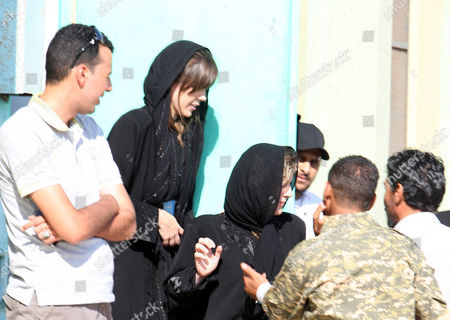 Australian Lawyer Melinda Taylor (2-l) and Her Interpreter From Lebanon Helen Assaf (2-r) Are Seen Following Their Release From Detention in Zintan a Town Southwest of Tripoli Libya 02 July 2012 Libya Released Four International Criminal Court Officials Detained Since Early June on Suspicion of Smuggling Documents to the Son of Slain Leader Moamer Gaddafi the Officials Were Released in the Western Town of Zintan where They Were Arrested by a Local Militia After a Visit to Saif Al-islam Gaddafi who is Wanted by the Icc For His Role in the Killing of Protesters During a Revolt Last Year That Ended His Father's Rule the Arrest of Australian Melinda Taylor the Icc-appointed Defence Counsel For Saif Al-islam Gaddafi and a Lebanese Translator on June 9 Deepened a Dispute Between the Icc and Libya Two Other Icc Officials who Had Stayed with Taylor Were Also Released Libyan Arab Jamahiriya Tripoli