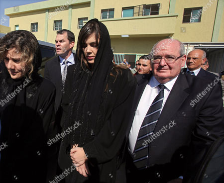Australian Lawyer Melinda Taylor (2-r) and Her Interpreter From Lebanon Helen Assaf (l) Are Seen Following Their Release From Detention in Zintan a Town Southwest of Tripoli Libya 02 July 2012 Libya Released Four International Criminal Court Officials Detained Since Early June on Suspicion of Smuggling Documents to the Son of Slain Leader Moamer Gaddafi the Officials Were Released in the Western Town of Zintan where They Were Arrested by a Local Militia After a Visit to Saif Al-islam Gaddafi who is Wanted by the Icc For His Role in the Killing of Protesters During a Revolt Last Year That Ended His Father's Rule the Arrest of Australian Melinda Taylor the Icc-appointed Defence Counsel For Saif Al-islam Gaddafi and a Lebanese Translator on June 9 Deepened a Dispute Between the Icc and Libya Two Other Icc Officials who Had Stayed with Taylor Were Also Released Libyan Arab Jamahiriya Tripoli
