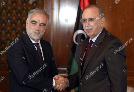 Chief Prosecutor of the International Criminal Court (icc) Luis Moreno Ocampo (l) Shakes Hands with Libyan Foreign Minister Abdel-rahim Al-keeb (r) in Tripoli Libya 19 April 2012 Media Reports State That Ocampo Arrived in Tripoli on 18 April For Talks on the Disputed Trial of Saif Al-islam the Son of Libya's Former Leader Muammar Gaddafi Gaddafi the Hague-based Court and Libya's New Leadership Are Locked in a Row Over where the 39-year-old Would Be Put on Trial on Charges of Crimes Against Humanity Libyan Arab Jamahiriya Tripoli