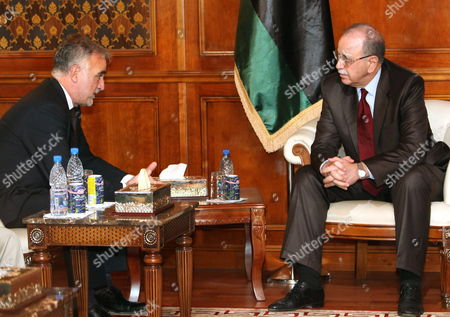 Chief Prosecutor of the International Criminal Court (icc) Luis Moreno Ocampo (l) Meets with Libyan Foreign Minsiter Abdel-rahim Al-keeb (r) in Tripoli Libya 19 April 2012 Media Reports State That Ocampo Arrived in Tripoli on 18 April For Talks on the Disputed Trial of Saif Al-islam the Son of Libya's Former Leader Muammar Gaddafi Gaddafi the Hague-based Court and Libya's New Leadership Are Locked in a Row Over where the 39-year-old Would Be Put on Trial on Charges of Crimes Against Humanity Libyan Arab Jamahiriya Tripoli