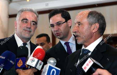 Chief Prosecutor of the International Criminal Court (icc) Luis Moreno Ocampo (l) Listens to Chairman of Libya's National Transitional Council Mustafa Abdul Jalil (r) During a Press Conference in Tripoli Libya 18 April 2012 Media Reports State That Ocampo Arrived in Tripoli on 18 April For Talks on the Disputed Trial of Saif Al-islam the Son of Libya's Former Leader Muammar Gaddafi Gaddafi the Hague-based Court and Libya's New Leadership Are Locked in a Row Over where the 39-year-old Would Be Put on Trial on Charges of Crimes Against Humanity Libyan Arab Jamahiriya Tripoli