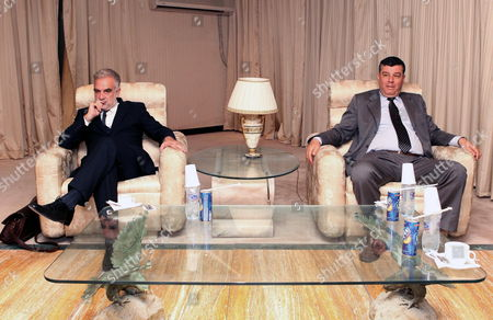 Libya's Attorney General Abdul Aziz Alhsady (r) Meets with Chief Prosecutor of the International Criminal Court (icc) Luis Moreno Ocampo (l) in Tripoli Libya 18 April 2012 Media Reports State That Ocampo Arrived in Tripoli on 18 April For Talks on the Disputed Trial of Saif Al-islam the Son of Libya's Former Leader Muammar Gaddafi Gaddafi the Hague-based Court and Libya's New Leadership Are Locked in a Row Over where the 39-year-old Would Be Put on Trial on Charges of Crimes Against Humanity Libyan Arab Jamahiriya Tripoli