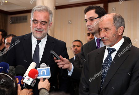 Chief Prosecutor of the International Criminal Court (icc) Luis Moreno Ocampo (l) and the Chairman of Libya's National Transitional Council Mustafa Abdul Jalil (r) During a Press Conference in Tripoli Libya 18 April 2012 Media Reports State That Ocampo Arrived in Tripoli on 18 April For Talks on the Disputed Trial of Saif Al-islam the Son of Libya's Former Leader Muammar Gaddafi Gaddafi the Hague-based Court and Libya's New Leadership Are Locked in a Row Over where the 39-year-old Would Be Put on Trial on Charges of Crimes Against Humanity Libyan Arab Jamahiriya Tripoli