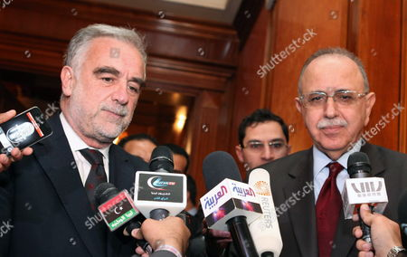 Chief Prosecutor of the International Criminal Court (icc) Luis Moreno Ocampo (l) and Libyan Foreign Minister Abdel-rahim Al-keeb (r) During a Press Conference in Tripoli Libya 19 April 2012 Media Reports State That Ocampo Arrived in Tripoli on 18 April For Talks on the Disputed Trial of Saif Al-islam the Son of Libya's Former Leader Muammar Gaddafi Gaddafi the Hague-based Court and Libya's New Leadership Are Locked in a Row Over where the 39-year-old Would Be Put on Trial on Charges of Crimes Against Humanity Libyan Arab Jamahiriya Tripoli