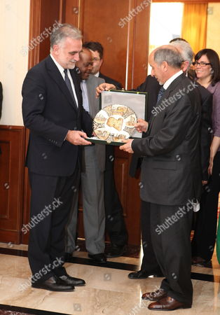 Chief Prosecutor of the International Criminal Court (icc) Luis Moreno Ocampo (l) Receives a Gift From the Chairman of Libya's National Transitional Council Mustafa Abdul Jalil (r) in Tripoli Libya 18 April 2012 Media Reports State That Ocampo Arrived in Tripoli on 18 April For Talks on the Disputed Trial of Saif Al-islam the Son of Libya's Former Leader Muammar Gaddafi Gaddafi the Hague-based Court and Libya's New Leadership Are Locked in a Row Over where the 39-year-old Would Be Put on Trial on Charges of Crimes Against Humanity Libyan Arab Jamahiriya Tripoli