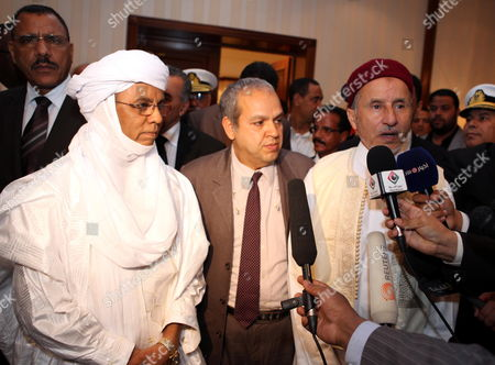 Chairman of Libya's National Transitional Council (ntc) Mustafa Abdul Jalil (r) with Niger Prime Minister Brigi Rafini (l) During a Press Conference in Tripoli Libya 04 May 2012 Libyan Arab Jamahiriya Tripoli