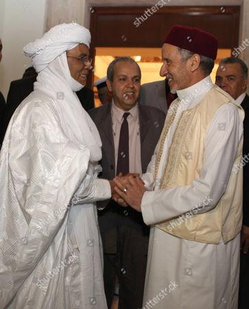 Stock Picture of Chairman of Libya's National Transitional Council (ntc) Mustafa Abdul Jalil (r) Shakes Hands with Niger Prime Minister Brigi Rafini (l) in Tripoli Libya 04 May 2012 Libyan Arab Jamahiriya Tripoli