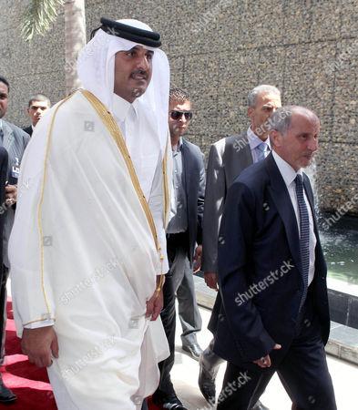 Stock Photo of Chairman of the Libyan National Transitional Council (ntc) Mustafa Abdul Jalil (r) Receives Qatari Crown Prince Sheikh Tamim Bin Hamad Bin Khalifa Al Thani (l) in Tripoli Libya 17 July 2012 Libyan Arab Jamahiriya Tripoli