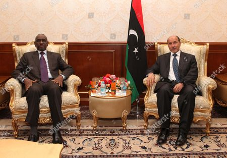 Libya's National Transitional Council (tnc) Chairman Mustafa Abdel Jalil (r) Sits Together with the First Vice-president of Sudan Ali Osman Mohamed Taha (l) As They Pose For the Media Prior to Their Meeting in Tripoli Libya 10 June 2012 Libyan Arab Jamahiriya Tripoli