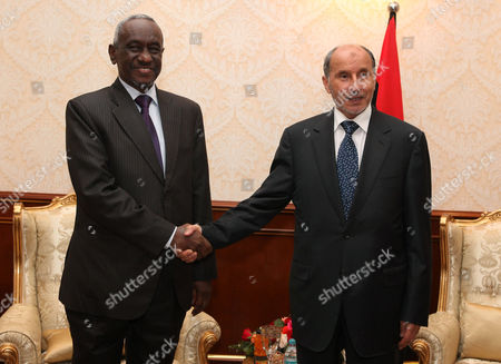 Libya's National Transitional Council (tnc) Chairman Mustafa Abdel Jalil (r) Shakes Hands with the First Vice-president of Sudan Ali Osman Mohamed Taha (l) As They Pose For the Media Prior to Their Meeting in Tripoli Libya 10 June 2012 Libyan Arab Jamahiriya Tripoli